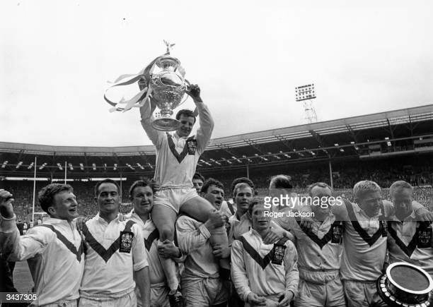 Jubillant St Helens players carry their skipper Alex Murphy on their shoulders after they had won the Rugby League Challenge Cup at Wembley stadium...
