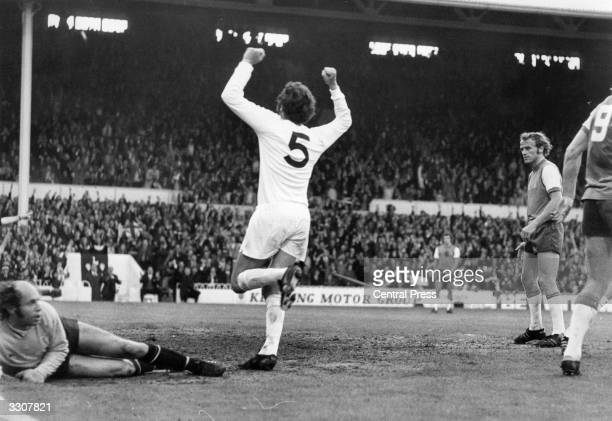 Mike England celebrates the scoring of Tottenham Hotspur's goal during the first leg of the UEFA Cup Final against Feyenoord whose goalkeeper Eddy...
