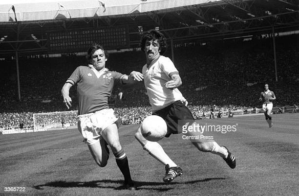 Manchester United's Steve Coppell attempts to tackle Liverpool's David Johnson during the FA Cup Final at Wembley Stadium Manchester United went on...