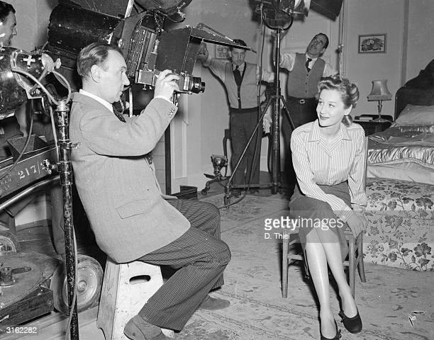 Sir Ralph Richardson lines up a shot of actress Margaret Leighton during the filming of 'Home at Seven' at Shepperton Studios Richardson directed and...
