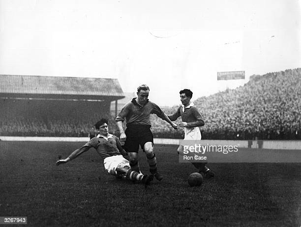Billy Wright Wolverhampton Wanderers and England captain tricks his way between Charlton Athletic players Derek Ufton and Cyril Hammond during a...