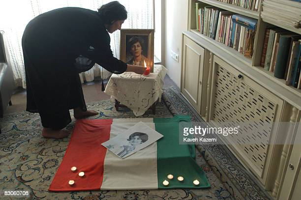 On the fourth anniversary of the murder of political activists Dariush and Parvaneh Forouhar, their daughter Parastou lays a shrine with the Iranian...