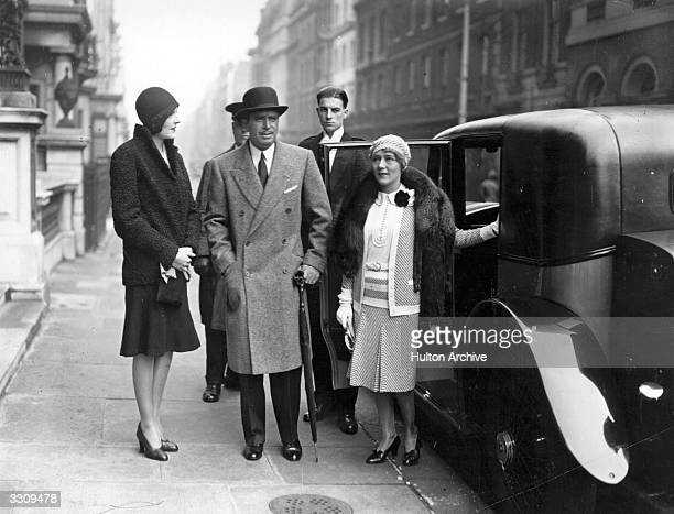 Douglas Elton Fairbanks Snr , the American film actor, with his wife and fellow film star Mary Pickford , whom he married in 1920 and subsequently...