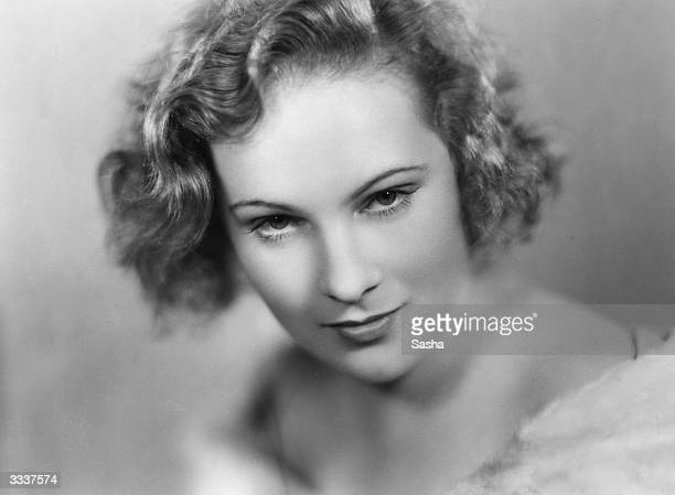 American actress Mollie Ellis who is playing one of the leading parts in the American production of 'Cynara' stares seductively at the camera