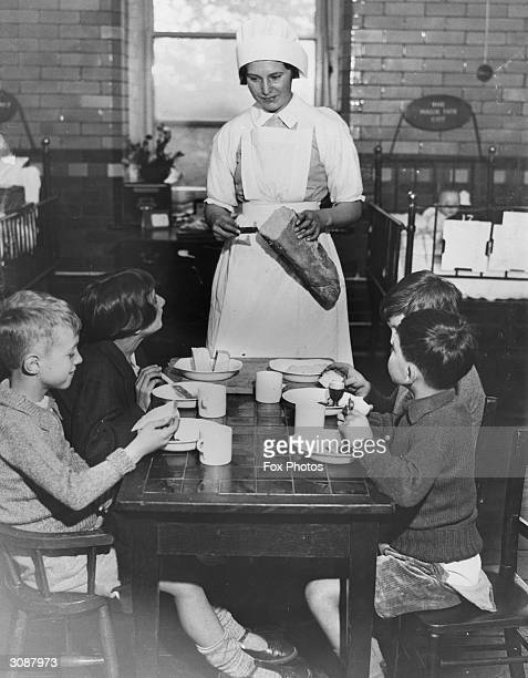 Young patients at Great Ormond St Hospital enjoy tea with Australian butter on their bread a gift from the Australian government