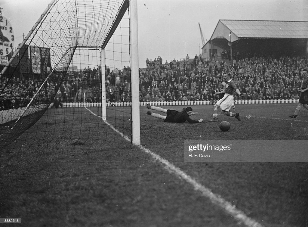 Norwich City goalkeeper, Hall, makes an outstanding save, to send the ball running harmlessly wide, as Millwall play Norwich city at the Den on the first day of the Wartime regional league competitions.