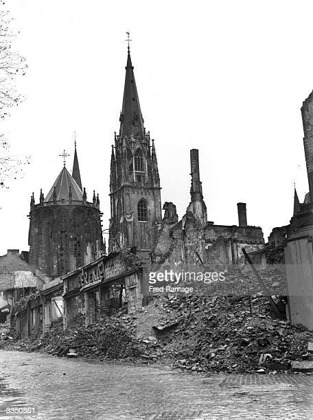 Aachen Cathedral rising above ruins in the foreground Aachen was the first large German city to fall into allied hands after their invasion in WW II