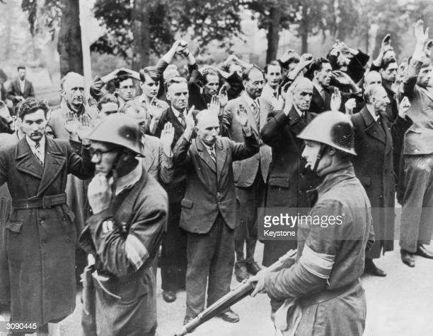 Armed Dutch patriots round up fellow townspeople accused of collaborating with the Nazis in Nijmegen.