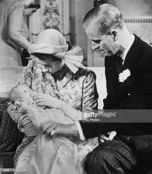 Princess Elizabeth and The Duke Of Edinburgh holding their baby daughter Princess Anne The baby given the names Anne Elizabeth Alice Louise was...