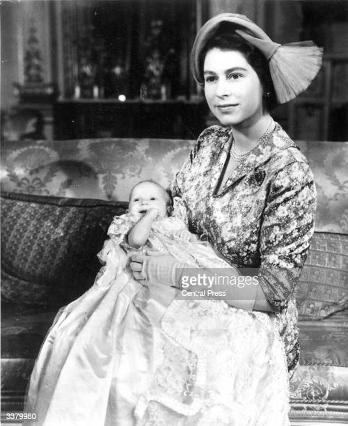Princess Elizabeth with her baby daughter Princess Anne who is wearing the Royal christening robe made of Honiton lace.