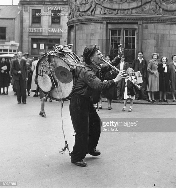 Street performer Arthur Griffiths a oneman band entertains onlookers on the streets of Hexham Original Publication Picture Post 5138 Down the Tyne...