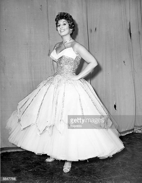 British singer Alma Cogan wearing a fullcircle evening dress