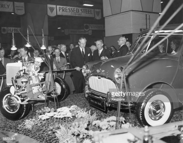 British prime minister Harold Macmillan viewing the engine and front suspension of a Morris MiniMinor at the Motor Show in Earls Court London