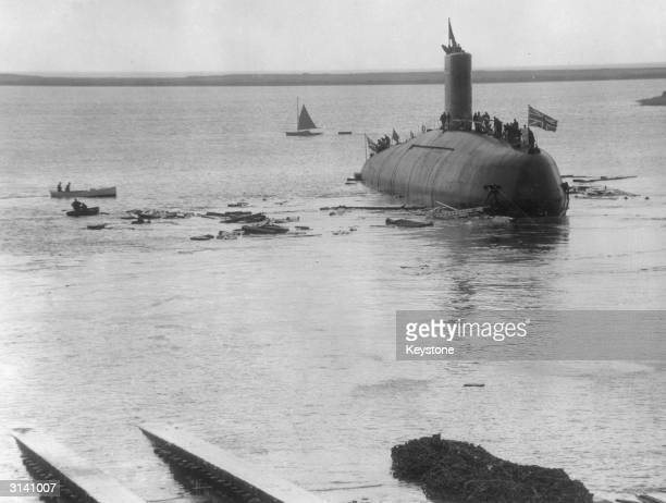 The crew stand on Britain's first nuclear submarine Dreadnought which is in the sea off BarrowinFurness Cumbria after the launching ceremony by Queen...