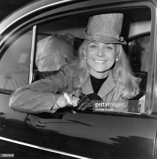 American pop singersongwriter Jackie DeShannon smiles from the back of a car
