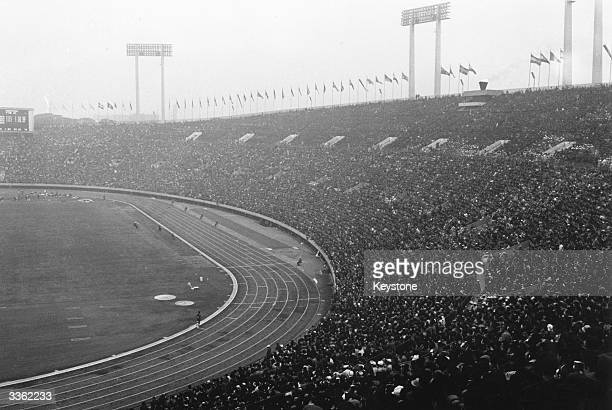 Marathon runner Abebe Bikila of Ethiopia entering Tokyo stadium for the finish of the Olympic marathon