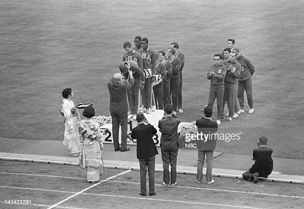 21st October 1964 Summer Olympics -- Pictured: US winning team accept their Gold Medal for the 4 x 100 meter relay during the 1964 Summer Olympics in...