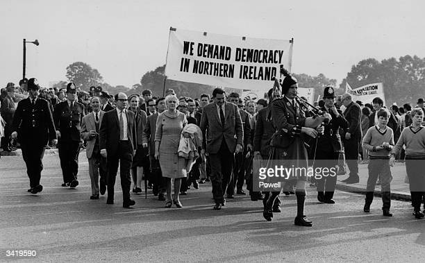 Labour MP Eric Heffer leads a civil rights march in London held by the Northern Irish Civil Rights Movement The slogan reads 'We Demand Democracy In...