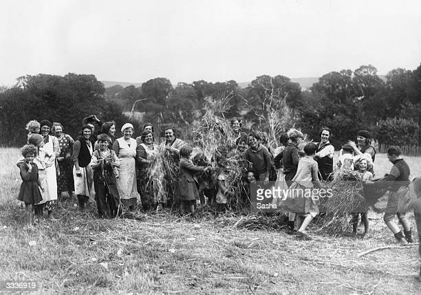 Hop Pickers at the Hop Pickers camp in Faversham Kent preparing a bonfire