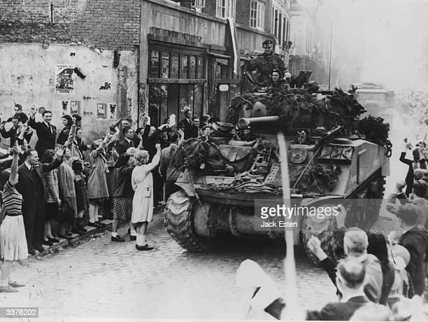 Dutch citizens cheering British Sherman tanks in Holland