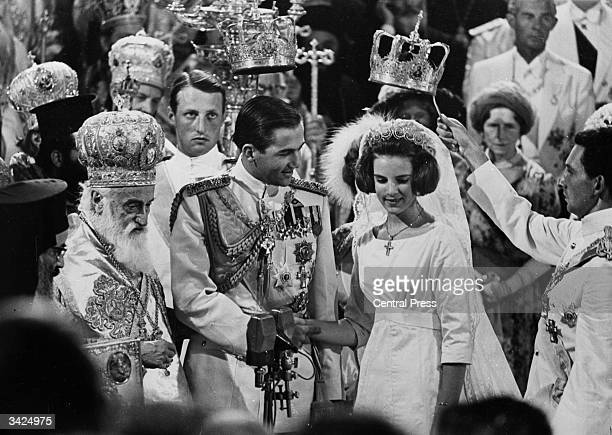 King Constantine of Greece and Princess AnneMarie of Denmark during their wedding in Athens Cathedral The service was conducted by Archbishop...