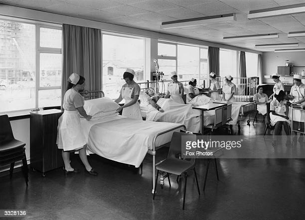 Student nurses learning how to make beds in the School of Nursing Charing Cross Hospital Group London