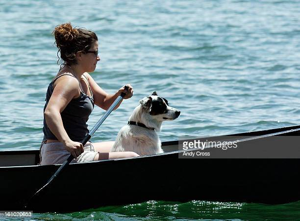 COMAY 21ST2005Vanessa Clarke <cq> from Denver <cq> paddles the canoe while one of her dogs on board Chagall navigates Dillon Reservoir Saturday...
