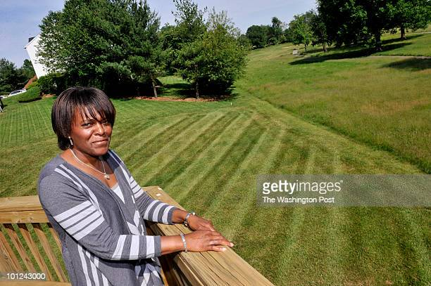 Standing on her deck Sandy Pruitt can see tall weeds and grass on the fairway of the hole behind her house back on May 21 2010 in Mitchellville Md...