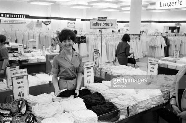 21yearold Lesley Chapman from Penge seen working behind the counter of the Oxford Street branch of Marks Spencer 7th July 1966