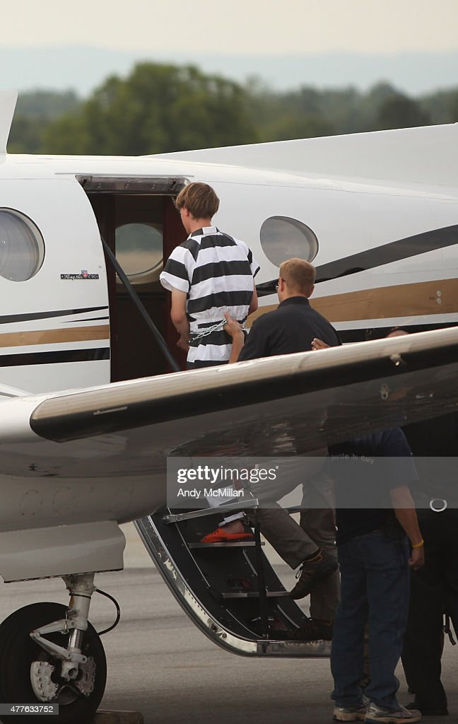 21-year-old suspect, Dylann Roof of Lexington, South Carolina, boards a plane at Shelby-Cleveland County Regional Airport for extradition back to Charleston, South Carolina on June 18, 2015 in Shelby, North Carolina. Roof is suspected of fatally shooting nine members of the Emanuel AME Church in Charleston on June 17.