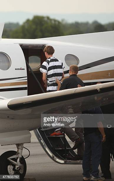21yearold suspect Dylann Roof of Lexington South Carolina boards a plane at ShelbyCleveland County Regional Airport for extradition back to...