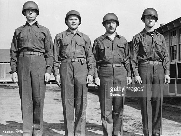 Monterey, CA: Former Yank center fielder Joe DiMaggio joins his fellow recruits in a bigger Yank outfit as he starts his first day of drill after...