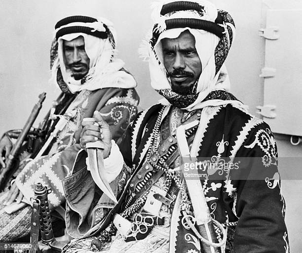 2/20/1945Cairo Egypt Colorfully garbed and well armed are these two members of the entourage of King Ibn Saud of Saudi Arabia as they appeared on the...