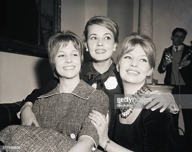 2/20/1959Paris France Offering dazzling dental displays the three beauties who will appear in French producer Roger Vadim's next film meet the press...