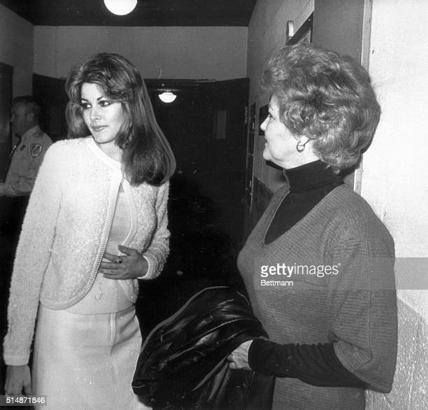 Ginger Alden Elvis Presley's former girlfriend is shown with her mother Jo Alden outside the courtroom where she is appearing before a special...