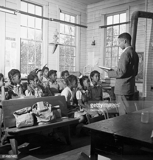 2/2/1947UnoVirginia Teacher Jackson is reading to his pupils here All of them were born in Uno and come from ten families that make up the entire...
