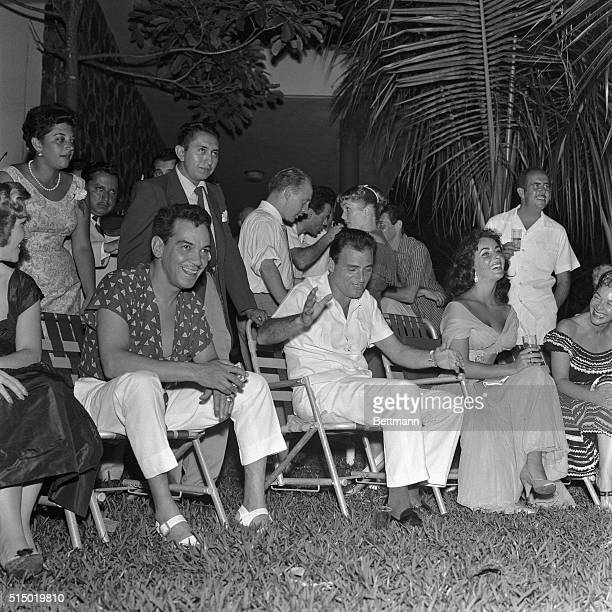 2/2/1957Acapulco Mexico Actress Elizabeth Taylor and film producer Michael Todd enjoy the entertainment at their wedding reception with friends...