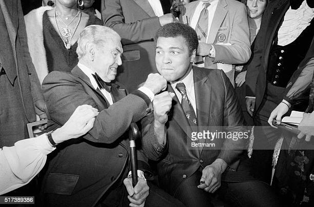 New York, NY- Jack Dempsey takes a poke at Muhammad Ali during the first Thurman Award Dinner of the Association for the Help of Retarded Children....