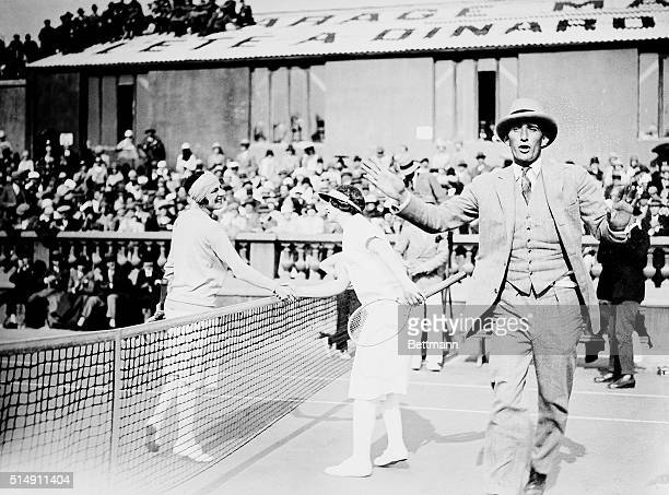 2/24/1926CannesFrance This is the first photo to arrive in America showing Suzanne Lenglen shaking hands with our own Helen Wills who lost The...