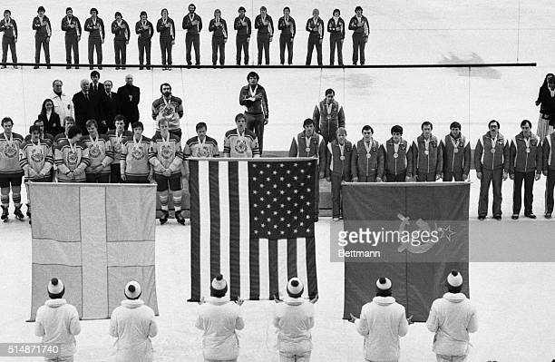 2/24/1980Lake Placid NY The medalwinning teams in the Olympic hockey competition line up for the singing of the national anthems during presentation...