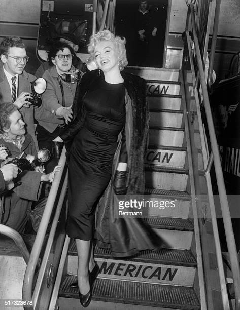 2/25/1956New York NY In Perfect form as usual Marilyn Monroe obliges lens corps at Idlewild as she boards American Airlines plane for Hollywood