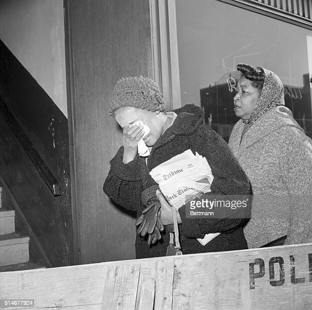 Embittered mourners leave the Unity Funeral Home in Harlem after viewing the body of Malcolm X who was assassinated February 21st as he began to...
