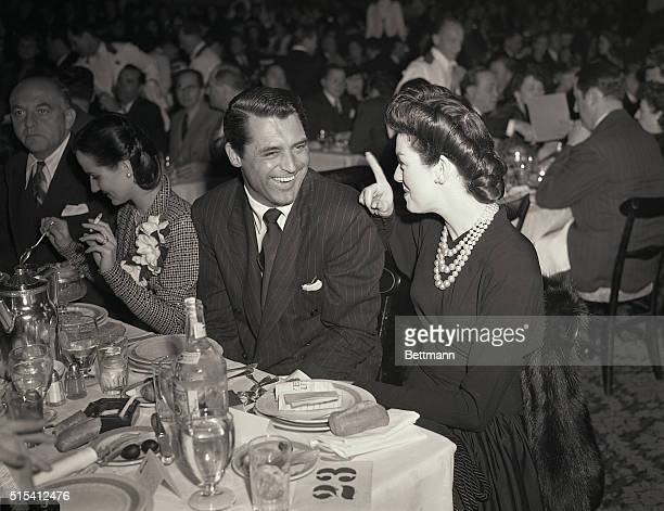 Hollywood, CA-Cary Grant and Rosalind Russell are shown here attending the war crimped awards banquet of the Academy of Motion Picture Arts and...
