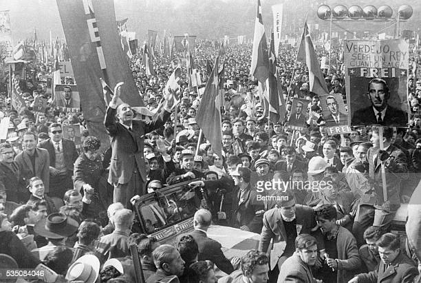 2/26/1964SantiagoChile Presidential candidate for the Christian Democrat Party Sen Eduardo Frei acknowledged the cheers from participants in the...
