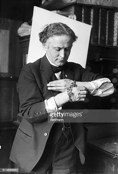 2/27/1918Harry Houdini getting out of handcuffs