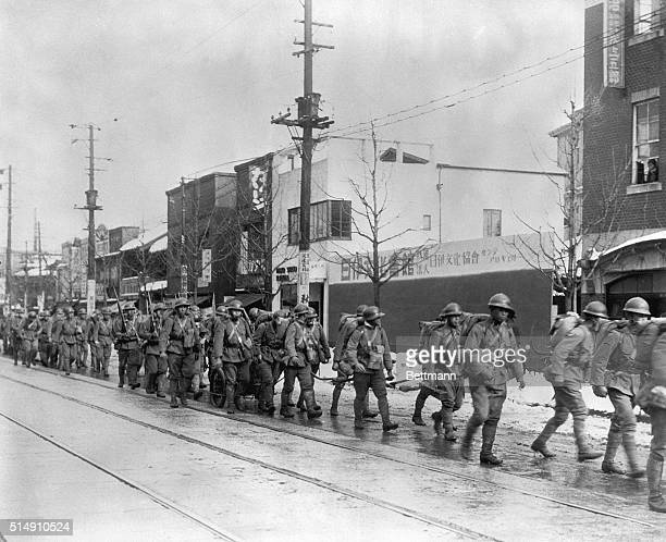 2/27/1936Tokyo JapanThe Imperial bodyguard moving to Army Hall to protect staff officers quartered there from the bloody coup of February 26th