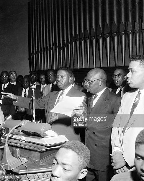 2/27/1956Montgomery ALRev Ralph D Abernathy motions in an attempt to restore order as he and other leaders of the Negro bus boycott receive a...