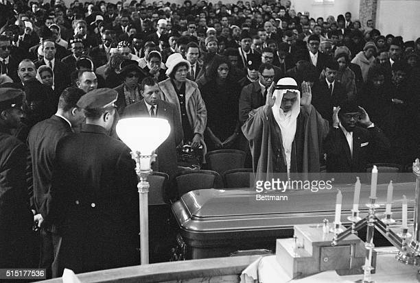 2/27/1965New York NY A sheik of the Moslem faith administers blessing at the coffin of Malcolm X during funeral services for the slain Negro...