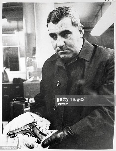 2/27/1967Lynn MA Detective Phillip J DiNatale of the Attorney General office holds the 32 caliber automatic Beretta that was said to have been...
