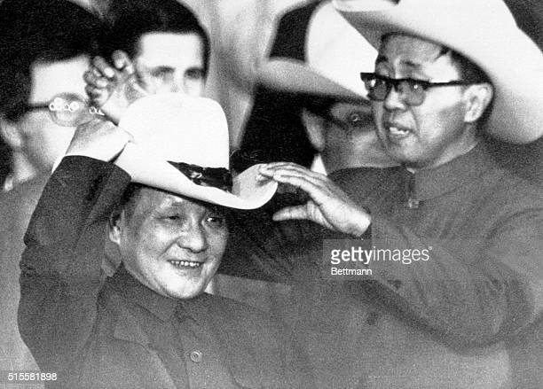 2/2/79Simonton Texas With the help of an aide Teng HsiaoPing tries on a cowboy hat presented to him at a rodeo 2/2 near Houston PH Brent Frerck